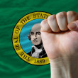 Us state flag of washington with hard fist in front of it symbol - Stock Photo