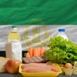 Basic food groceries in front of afghanistan national flag - Stockfoto
