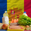 Постер, плакат: Basic food groceries in front of andorra national flag