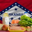 Stock Photo: Basic food groceries in front of arkansas us state flag