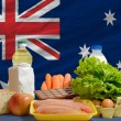 Basic food groceries in front of australia national flag — Stock Photo