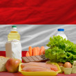 Basic food groceries in front of austria national flag — ストック写真