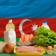Stock Photo: Basic food groceries in front of azerbaijnational flag