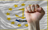 Us state flag of rhode island with hard fist in front of it symb — Stock Photo