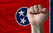 Us state flag of tennessee with hard fist in front of it symboli — Stock Photo