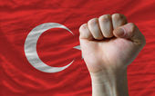 Hard fist in front of turkey flag symbolizing power — Stock Photo