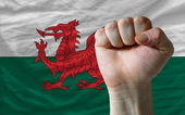 Hard fist in front of wales flag symbolizing power — Stock Photo