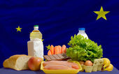 Basic food groceries in front of alaska us state flag — Stock Photo
