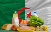 Basic food groceries in front of algeria national flag — Stock Photo