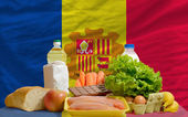 Basic food groceries in front of andorra national flag — Stock Photo