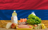 Basic food groceries in front of armenia national flag — Stock Photo
