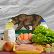 Basic food groceries in front of california us state flag - Stock Photo