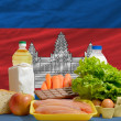 Basic food groceries in front of cambodia national flag — Stock Photo