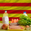 Stock Photo: Basic food groceries in front of cataloninational flag