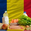 Basic food groceries in front of chad national flag — Stock Photo