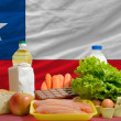 Stock Photo: Basic food groceries in front of chile national flag