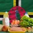Basic food groceries in front of dominicnational flag — Stock Photo #11031668