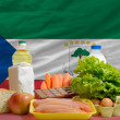 Stock Photo: Basic food groceries in front of equatorial guinenational flag