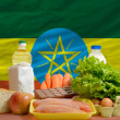 Basic food groceries in front of ethiopia national flag - Stock Photo