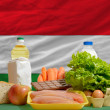 Basic food groceries in front of hungary national flag — Stock Photo #11032144