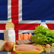Stock Photo: Basic food groceries in front of iceland national flag