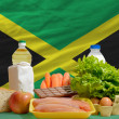 Basic food groceries in front of jamaica national flag — Stock Photo