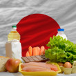 Stock Photo: Basic food groceries in front of japnational flag