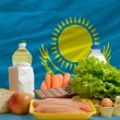 Basic food groceries in front of kazakhstnational flag — Stock Photo #11032503