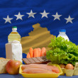 Basic food groceries in front of kosovo national flag — Stock Photo