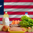 Basic food groceries in front of liberia national flag — Zdjęcie stockowe