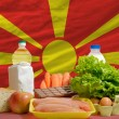 Stock Photo: Basic food groceries in front of macedoninational flag