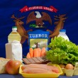 Basic food groceries in front of michigan us state flag - Stock Photo