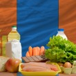 Stock Photo: Basic food groceries in front of mongolinational flag
