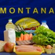 Basic food groceries in front of montana us state flag — Stock Photo