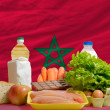 Basic food groceries in front of morocco national flag — Photo