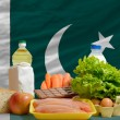 Basic food groceries in front of pakistan national flag — Stock Photo