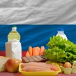 Basic food groceries in front of russia national flag — Stock Photo