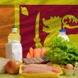 Basic food groceries in front of sri lanknational flag — Stock Photo #11034609