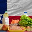 Basic food groceries in front of texas us state flag — Stock Photo