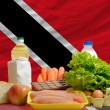 Basic food groceries in front of trinidad tobago national flag — Stock Photo #11035160