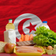 Basic food groceries in front of tunisinational flag — Stock Photo #11035256