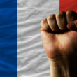 Hard fist in front of france flag symbolizing power — Stock Photo