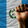 Hard fist in front of guatemala flag symbolizing power — Foto de Stock