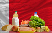 Basic food groceries in front of bahrain national flag — Stock Photo