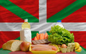 Basic food groceries in front of basque national flag — Stock Photo