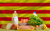 Basic food groceries in front of catalonia national flag — Stock Photo