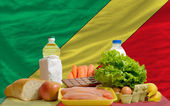 Basic food groceries in front of congo national flag — Stock Photo