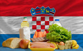 Basic food groceries in front of croatia national flag — Stock Photo