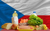 Basic food groceries in front of czech national flag — Stock Photo