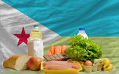Basic food groceries in front of djibouti national flag — Stock Photo